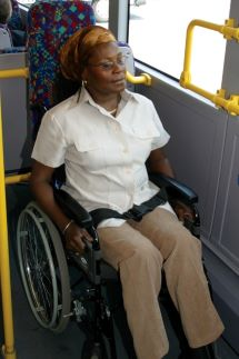 Woman in wheelchair on bus