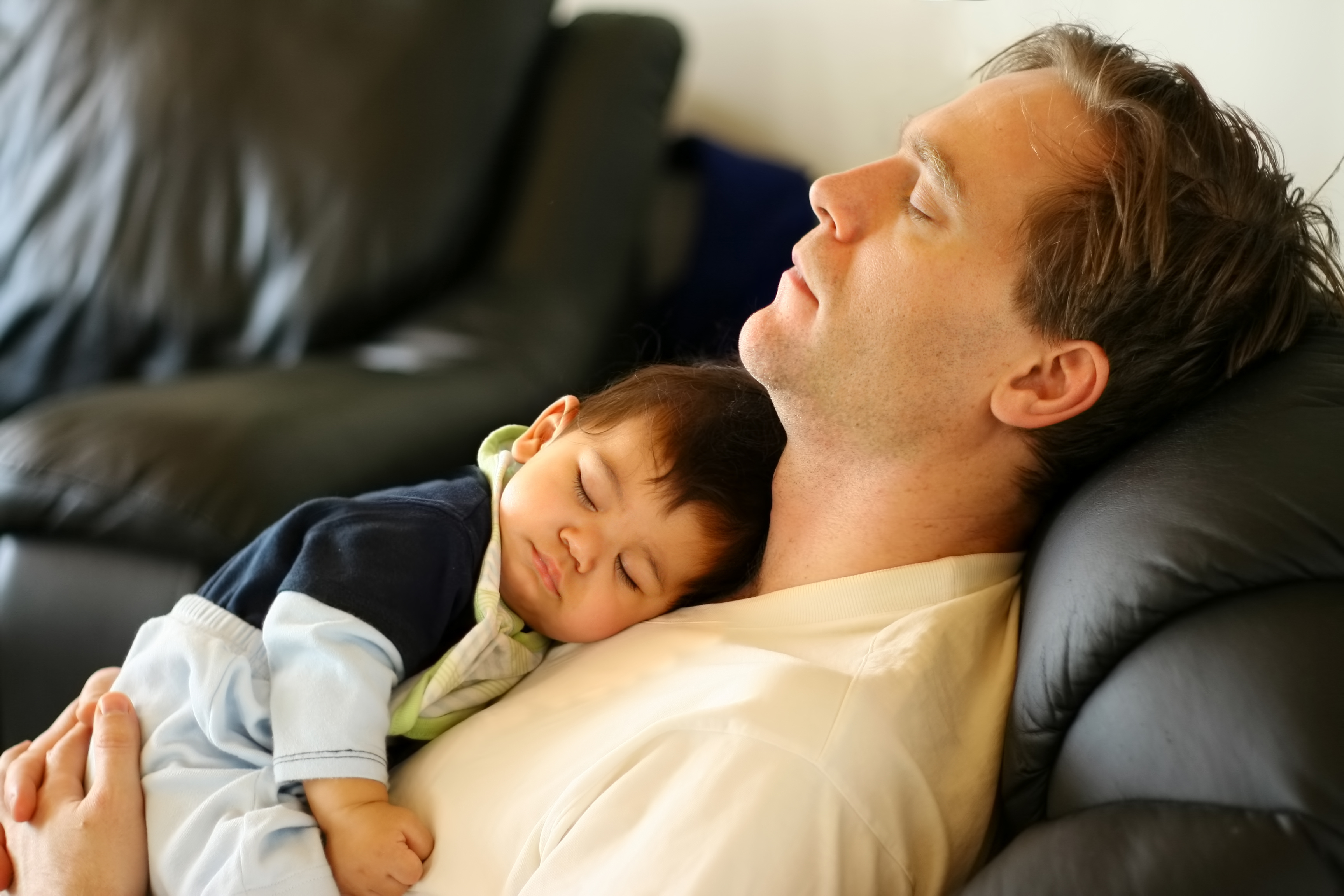 white dad and sleeping baby