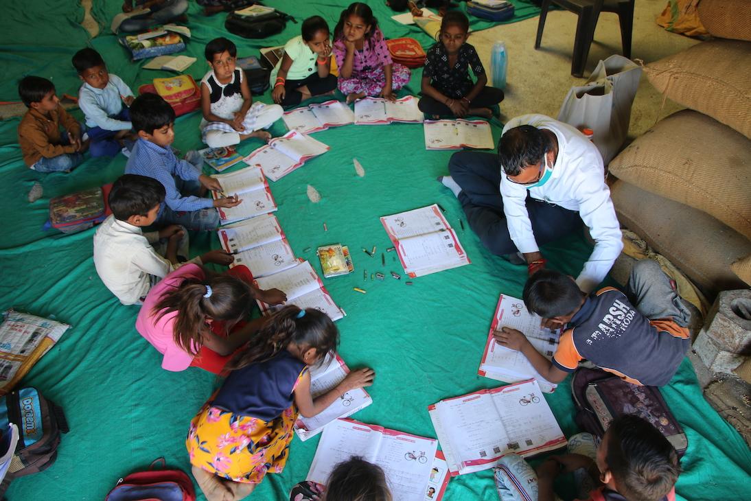 Teacher from India NeTT program working with children.