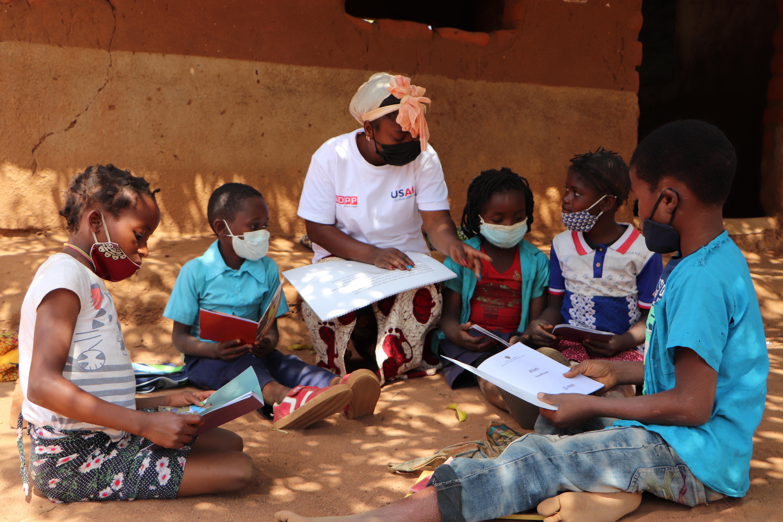 Teacher working with children in Mozambique