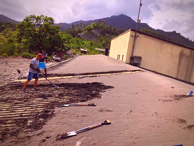 Clean-up of volcanic ash at Richmondvale Academy after the April eruptions.