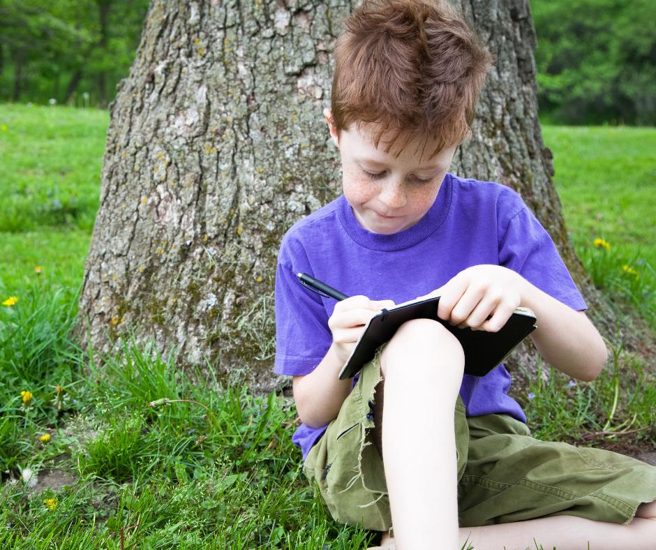 Boy nature journaling