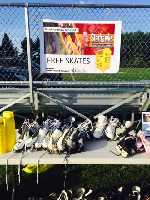 Planet Aid donates ice skates Applefest 2015