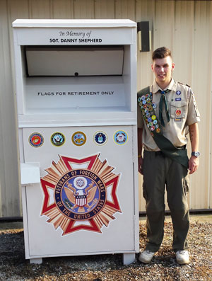 Logan Keenan refurbishes Planet Aid bin for Eagle Scout project