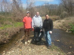 Planet Aid's Frank Rapone, David Bauer and Patrick Danielson help clean up Penny Pack Creek.