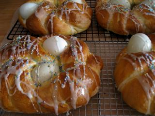 Braided, decorated Easter breads cooling on a rack