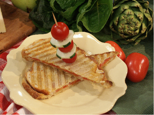 Grilled panini sliced and on a serving plate
