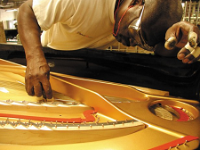 hand crafting a piano