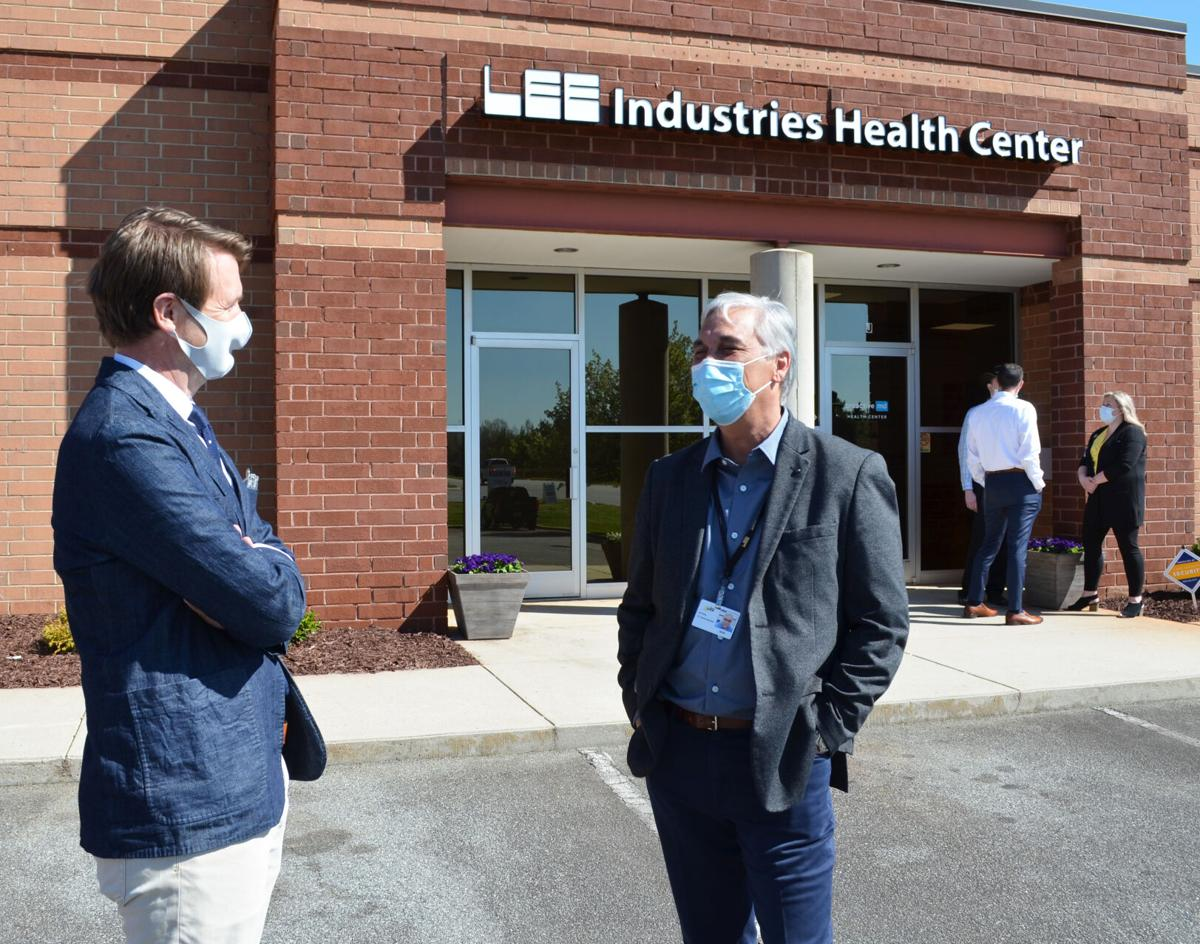 LEE Industries President Russell Towner, left, and Chief People Leader Julio Wong discuss the company's new health center in Conover.  Photo by Virginia Annable, Hickory Daily Record