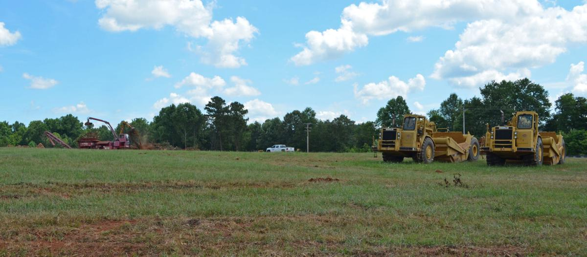 McCreary Modern is starting work to grade land where a new 80,000-square-foot manufacturing facility will go on U.S. 321 Business South. Photo by Virginia Annable, Hickory Daily Record