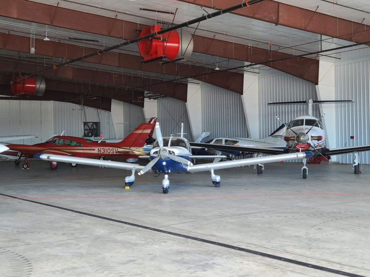 The Hickory City Council and Burke County Board of Commissioners approved a new agreement for a 12,000-square-foot hangar at the Hickory Regional Airport.  Here, several planes are seen in one of the airport's existing hangars.  Photo - KEVIN GRIFFIN, RECORD