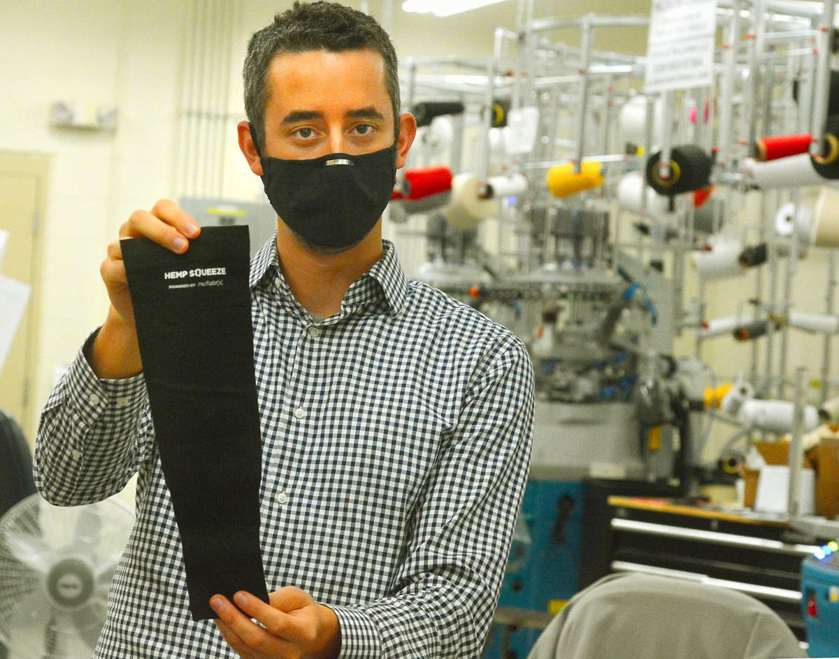 Jordan Schindler, founder and CEO of Nufabrx, displays an arm sleeve his company manufactured in this file photo from May of last year. The company pivoted to making masks from the same material in 2020.  Photo - ROBERT C. REED, RECORD