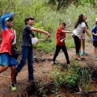 Kids throwing seeds   Oct. 2017