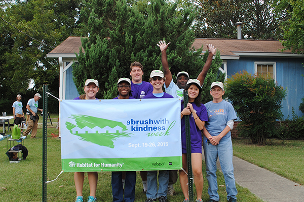 Volunteers get ready to paint at A Brush With Kindness Week