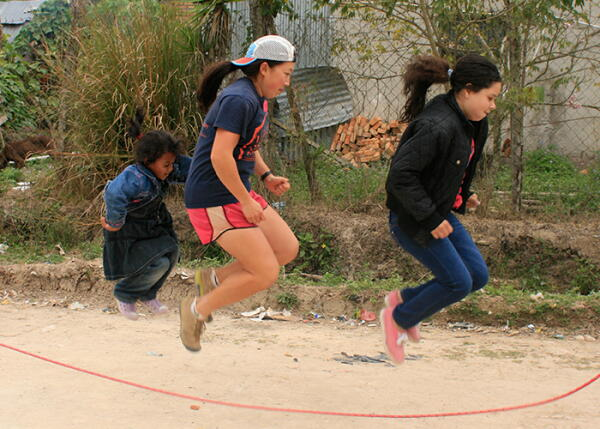 A volunteer jumps rope with kids in Honduras