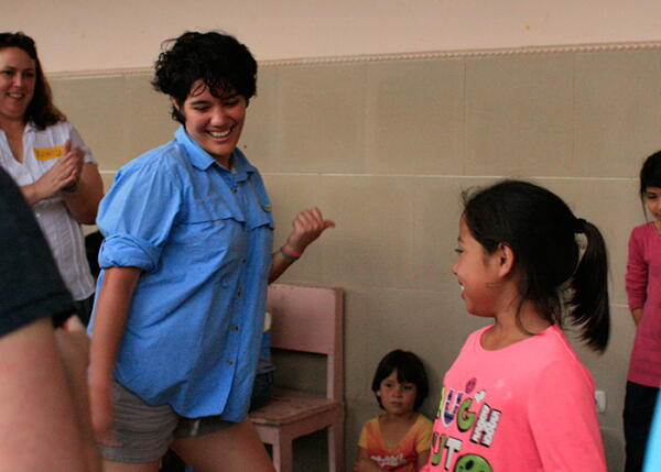 A volunteer dances with a child in Honduras