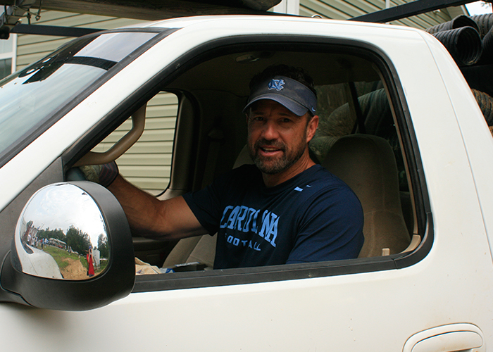 Coach Fedora volunteers with Habitat