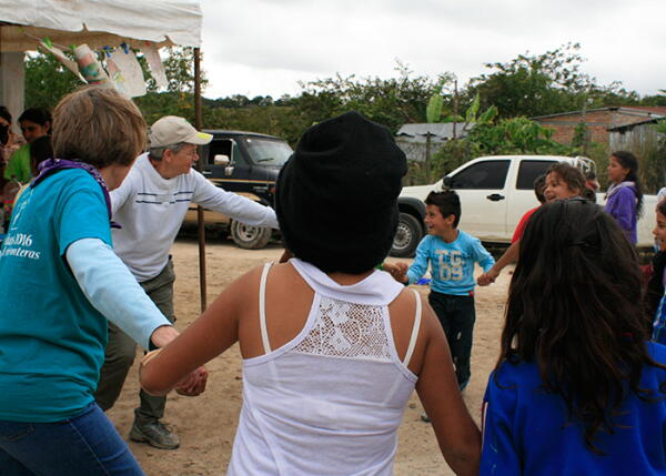 Volunteers dancing at the dedication in Honduras