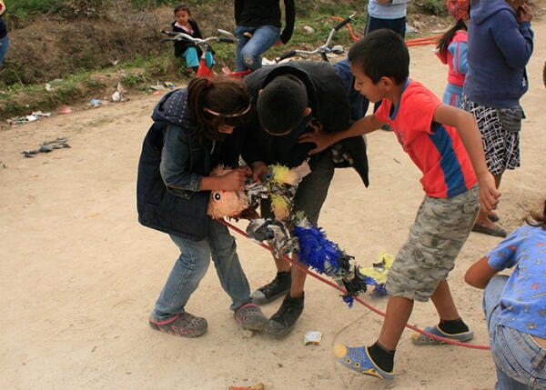 Kids search for candy in a pinata