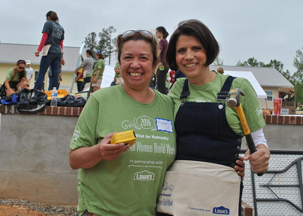Future homeowner Suyapa Mejia and LisaMarie Smith pose for a photo at Women Build