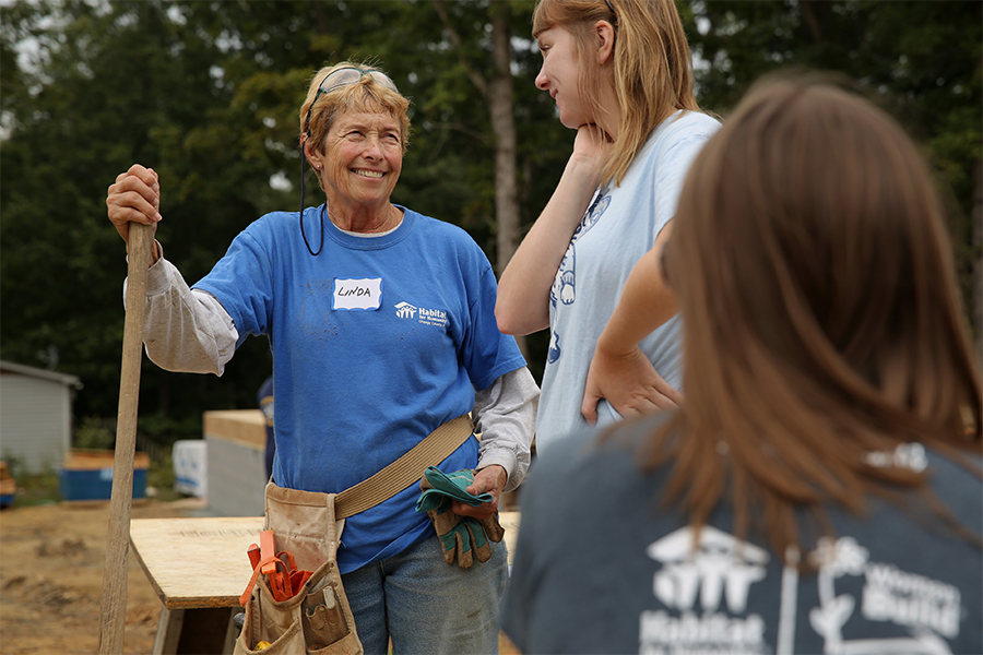 Linda Heffernan volunteers on the construction site